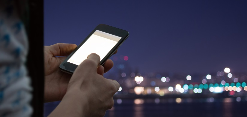 image of woman using mobile phone in the dark