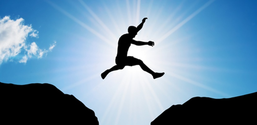 image of man leaping across a large gap