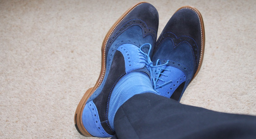 image of man's feet in blue suede shoes